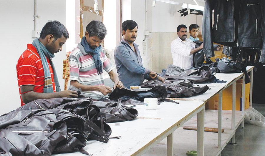 The finishing of leather jackets is a meticulous task – the rivets are attached by hand, the leather is buffed using lighter flames and Aloe Vera cream